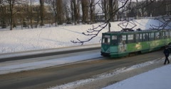 Green Tram is Moving City Panorama Pedestrians People Are Walking by a Street Stock Footage