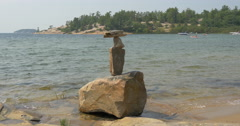 View of stacked stones on the lake shore at Killbear Provincial Park Stock Footage