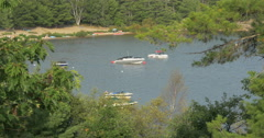 Boats on the lake seen through trees at Killbear Provincial Park Stock Footage