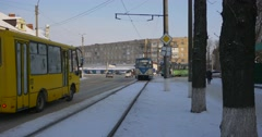 People Are Walking by a Street Two Trams Moving by a Railroad Yellow Bus and Stock Footage