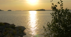 Sun reflection and calm waves in the lake at Killbear Provincial Park - stock footage