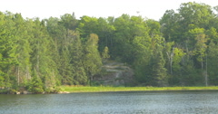 Lake surrounded by rocks, trees and vegetation at Killbear Provincial Park Stock Footage