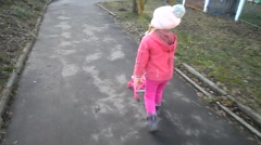 Girl walking with a pram Stock Footage