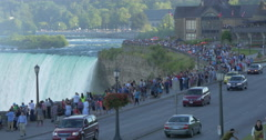 Big crowd walking and looking at the waterfall at Niagara Falls, Canada Stock Footage