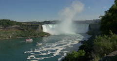 View of two boats navigating near the waterfall at Niagara Falls, Canada - stock footage