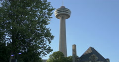 View of Skylon Tower and a tree at Niagara Falls, Canada Stock Footage