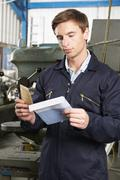 Factory Worker Opening Wage Packet Stock Photos