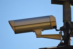 Stock Photo of gray surveillance camera