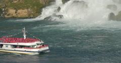 Beautiful view of a boat navigating near the waterfall at Niagara Falls, Canada - stock footage