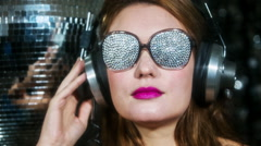 Sunglasses sexy babe headphones diva party disco woman Stock Footage