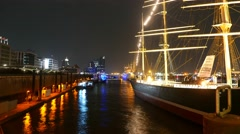 Old sailing ship at Hamburg harbour at night- beautiful time lapse Stock Footage