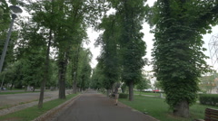 Walking and riding bikes in Central Park, Cluj-Napoca Stock Footage