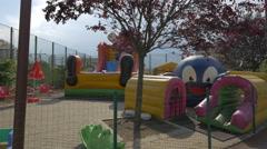 Inflatable slide in Iulius Park, Cluj-Napoca Stock Footage
