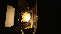 Stock Video Footage of Dolly: Video studio fresnel lens spot light on black background