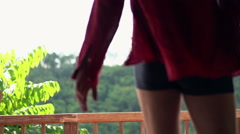 Man walking out on terrace and admire view, super slow motion Stock Footage