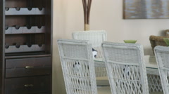 Wicker chairs and table set with discount in showroom of modern furniture store Stock Footage