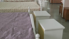 White beds and bedsteads in showroom of modern furniture store Stock Footage