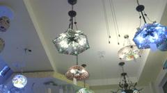 Modern ceiling lights in lighting store showroom Stock Footage