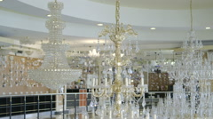 Ceiling crystal chandelier in lighting store showroom Stock Footage
