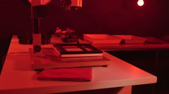 Stock Video Footage of Photography darkroom with red lighting and equipment for film print processing