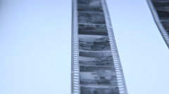 Strips of 35mm black and white film negatives ready for cutting and archiving - stock footage