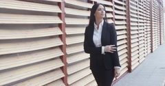Stock Video Footage of Stylish businesswoman in a hurry
