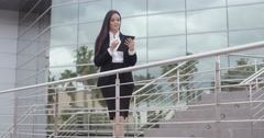 Stock Video Footage of Young businesswoman standing on a concourse