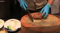 Chef cook peking roast duck in restaurant. Siam Paragon Mall. Bangkok, Thailand Stock Footage