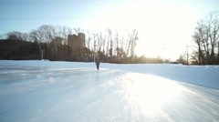 Skating woman in ice arena Stock Footage