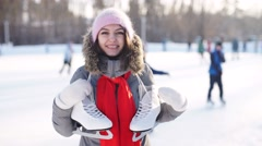 ice skating winter woman holding ice skates outdoors in snow. - stock footage