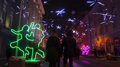 People in Moscow walk along Christmas street lighting decoration Stock Footage
