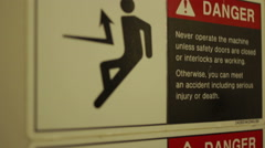 Danger Sign On Wall - Dolly Down Shot Stock Footage
