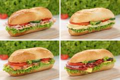 Collection of sub deli sandwiches baguettes with ham, salami and cheese Stock Photos
