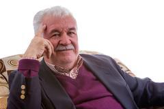 Thoughtful retired elderly gentleman - stock photo