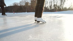 Young woman skating on ice with figure skates outdoors in the snow - stock footage