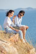 portrait of asian younger man and woman relaxing vacation at sea side happine - stock photo