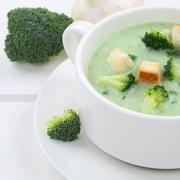 Healthy eating broccoli soup in cup closeup - stock photo