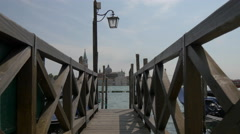 Wooden pier with old lamp post in Venice Stock Footage