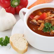Healthy eating goulash soup with meat and paprika in cup closeup Stock Photos
