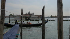 Laguna Veneta with gondolas, boats and San Giorgio Maggiore Church, Venice Stock Footage