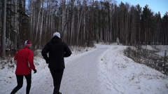 sports people jogging in the winter forest - stock footage