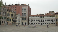Kids running and playing in Campo San Polo in Venice Stock Footage