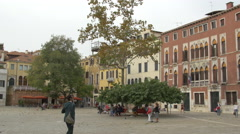 Tourists relaxing in Campo San Polo in Venice Stock Footage
