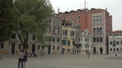 Adults and children relaxing in Campo San Polo in Venice Stock Footage