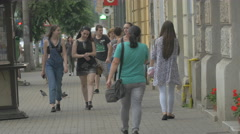 Girls walking in a square in Cluj-Napoca Stock Footage
