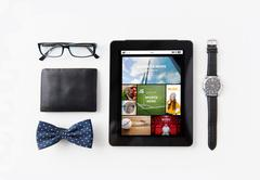 Tablet pc with web applications and personal stuff Stock Photos
