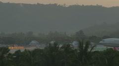 Boeing 777 landing in Phuket Airport at sunset Stock Footage