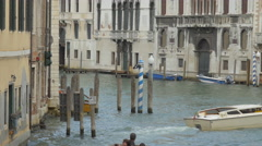 Small boats with tourists sailing in Grand Canal and Rio dei Tolentini in Venice Stock Footage