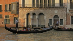 Stock Video Footage of Iconic view of two men rowing gondolas in Canal Grande, Venice