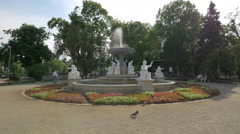 Walking next to the beautiful fountain in Central Park, Cluj-Napoca Stock Footage